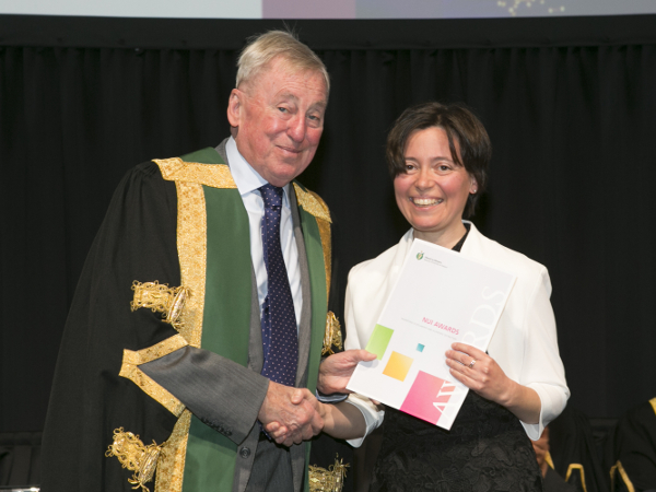 NUI Chancellor Dr Maurice Manning presenting the 2018 NUI Scholarship in Education to Daniela Donghi, NUI Galway.