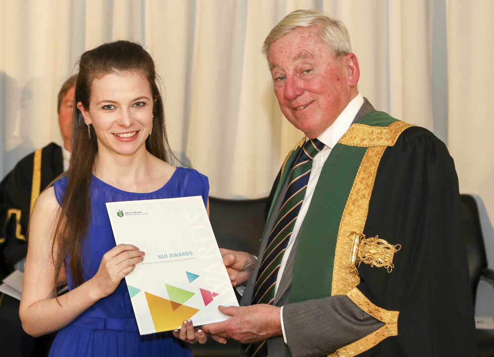 NUI Chancellor Dr Maurice Manning presenting the NUI Scholarship in Education 2019 to Sarah McAvoy