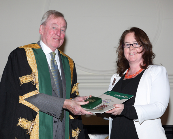 Margaret O'Sullivan receiving the NUI Denis Phelan Scholarship from NUI Chancellor Dr Maurice Manning at the NUI Awards Ceremony 2016.